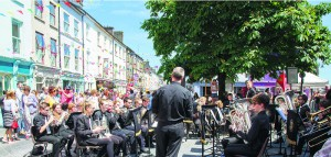 Ger Condon conducts the Clonakilty Brass Band, which entertained a huge appreciative audience at the last Saturday's Clonakilty Street Carnival. The band will compete in the senior category of the Clonakilty South of Ireland championships on Saturday, July 1st next, when 32 bands from all over the country will be in attendance.(Photo: George Maguire)
